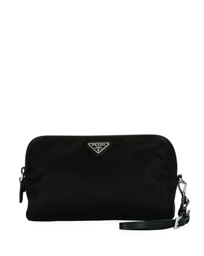 7c81815ee3 Quick Look. Prada · Vela Medium Triangle Cosmetics Bag. Available in Black