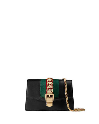 Gucci Sylvie Super Mini Leather Wallet on a