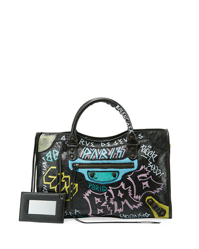 000ec518ef Quick Look. Balenciaga · Classic City AJ Graffiti-Print Satchel Bag.  Available in Black